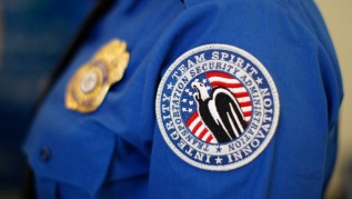 he Transportation Security Administration has fired two screeners for conspiring to fondle male passengers as they came through a security checkpoint at Denver International Airport.